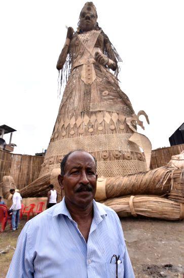 Muslim artisan Nuruddin Ahmed in front of the Durga idol he created at Bishnupur area of Guwahati.