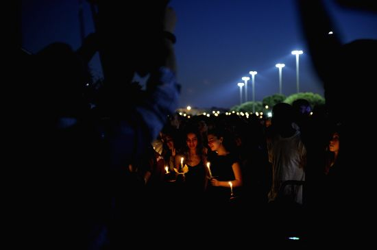 PARKLAND, Feb. 16, 2018 - People hold candles during a vigil for the victims of the shooting at Marjory Stoneman Douglas High School, in Parkland, Florida, the United States, Feb. 15, 2018. Seventeen ...