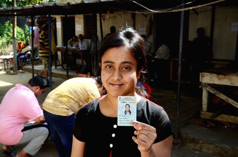 A first time voter shows her voter card after casting her vote at a polling station during Ranchi Municipality Elections in Ranchi, Jharkhand on April 16, 2018.
