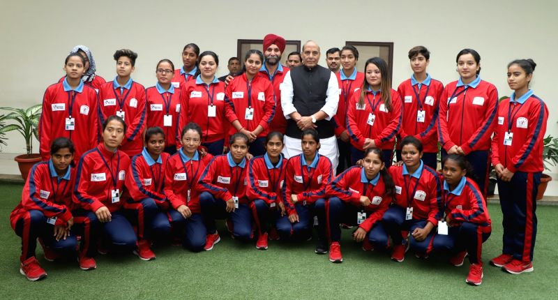 A group of women football players from Jammu and Kashmir calls on Union Home Minister Rajnath Singh in New Delhi on Dec 5, 2017.