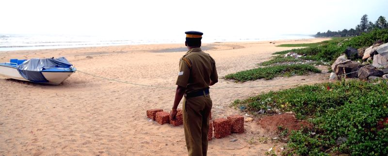 A policemen deployed at the Payyambalam beach in Kannur in the wake of cyclonic storm Ockhi that hit the southern districts of Kerala and Tamil Nadu on Dec 2, 2017.