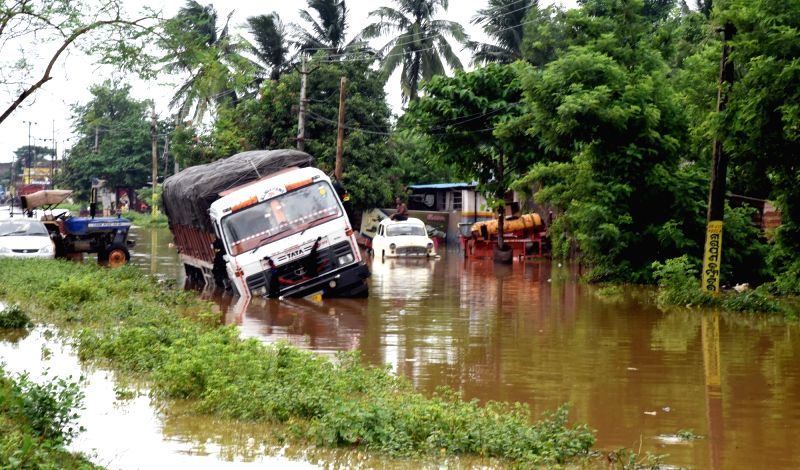 A truck stuck in floods in Bhubaneswar on Juy 21, 2018.(Image Source: IANS)