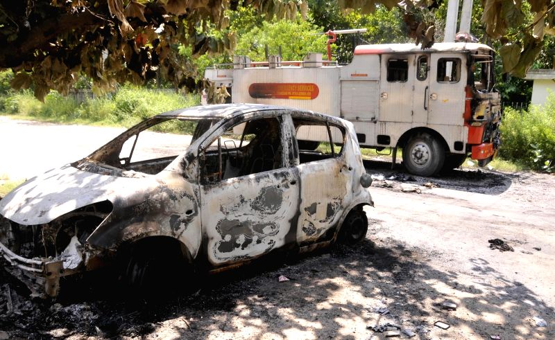 A view of a charred vehicle after unruly followers went on rampage following the conviction of Gurmeet Ram Rahim Singh in a rape case by a Haryana court in New Delhi on Aug 26, 2017.