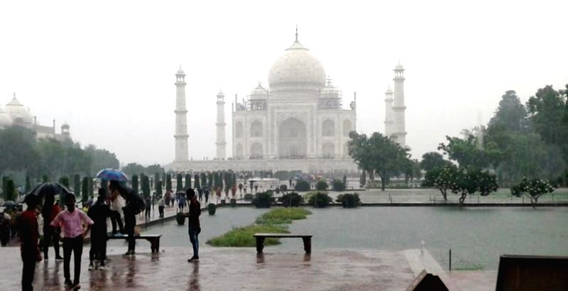 A view of the flooded green lawns of the Taj Mahal after heavy rains lashed Agra, on Aug 15, 2018.(Image Source: IANS)