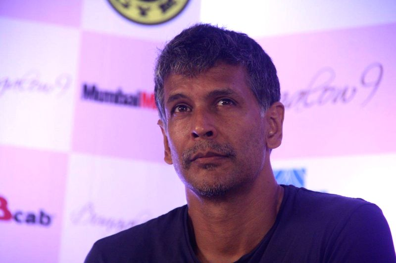 Actor Milind Soman extends his support to HCG Pinkathon 2013, during a press conference to announce ...