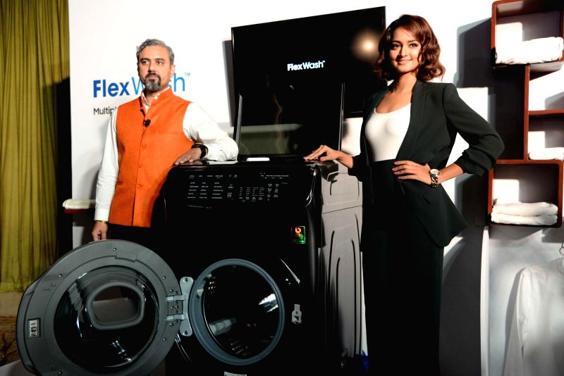 Actress Shanvi Srivastava and Samsung India Consumer Electronics director Rishi Suri at the launch of Samsung's