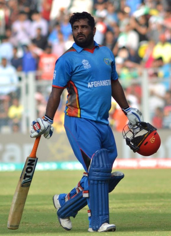 Afghan batsman Mohammad Shahzad returns back to the pavilion after getting dismissed during a WT20 match between South Africa and Afghanistan at Wankhede Stadium in Mumbai on March 20, 2016.