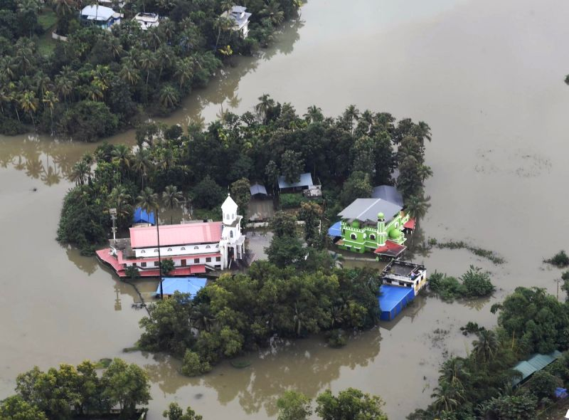 An aerial view of the flood-hit areas of Kerala on Aug 18, 2018. Overflowing rivers and a series of landslides have caused the death of 180 people as of Saturday morning, with over three lakh ...(Image Source: IANS/PIB)