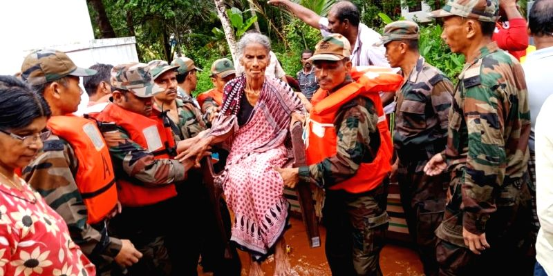 Army personnel help an old women at flood affected area, in Kerala, on  Aug 17, 2018.(Image Source: IANS/PIB)