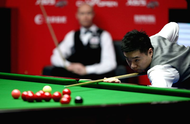 BEIJING, April 4, 2015 - China's Ding Junhui competes during his ...