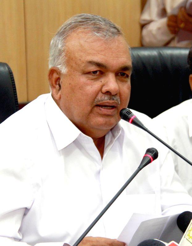 Karnataka Transport Minister Ramalinga Reddy addresses during a press conference regarding reduction of KSRTC and BMTC bus fares, in Bengaluru on Jan. 7, 2014.