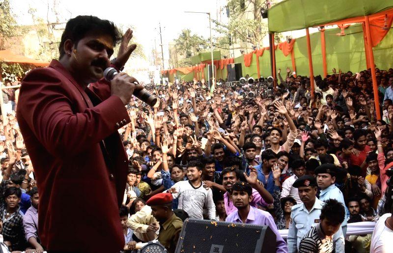 Bhojpuri singer Pawan Singh performs during a 'Holi Milan Samaroh' in Patna on March 10, 2017.