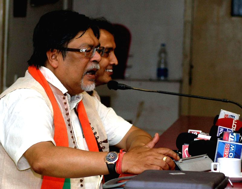 BJP candidate from Hooghly Lok Sabha constituency Chandan Mitra addressing media in Kolkata on April 12, 2014.(Image Source: IANS)