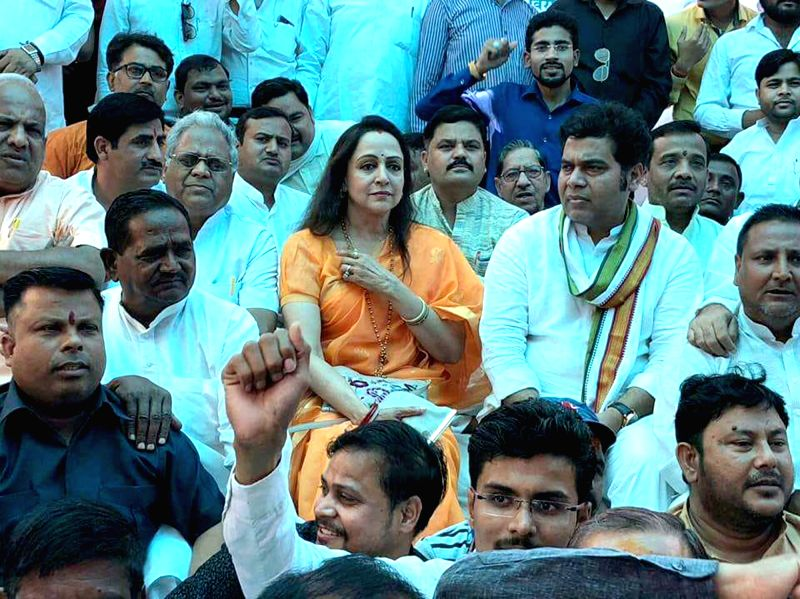 BJP leaders Hema Malini and Shrikant Sharma, along with party workers observe a day-long fast to protest the disruption of Parliament's budget session by opposition parties; in Mathura on ...(Image Source: IANS)