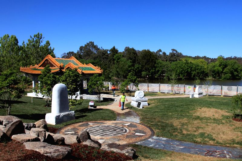 Gardeners work at the final touches of Beijing Garden in Canberra ...