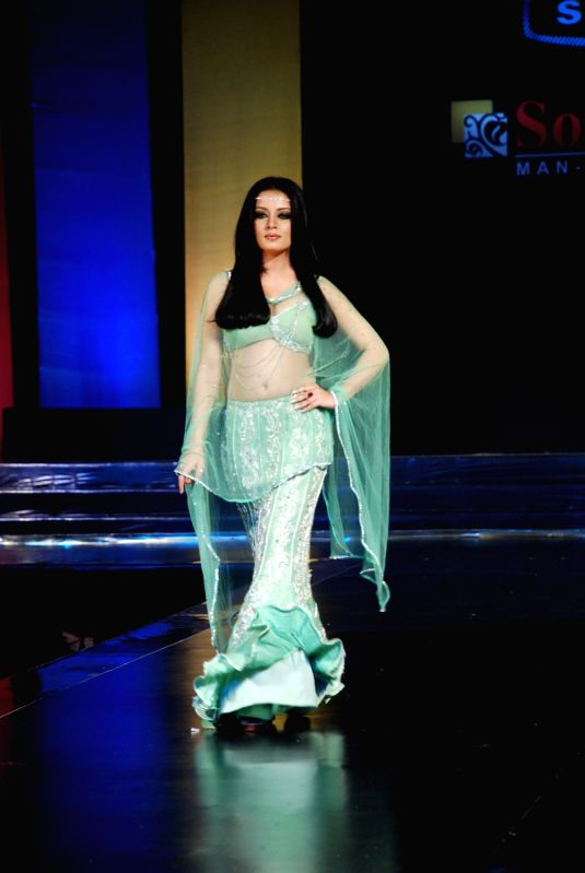 Model walks the ramp for top designers on Source Show at ...