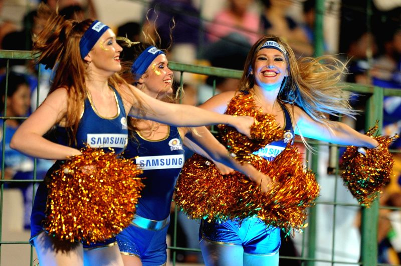 Cheerleaders perform during Qualifier 2 of IPL 2017 between Mumbai Indians and Kolkata Knight Riders at M Chinnaswamy Stadium in Bengaluru on May 19, 2017.