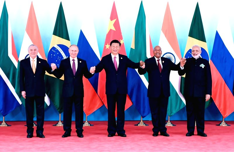 : Chinese President Xi Jinping (C) and other leaders of BRICS countries pose for a group photo before the 2017 BRICS Summit in Xiamen, southeast China's Fujian ...