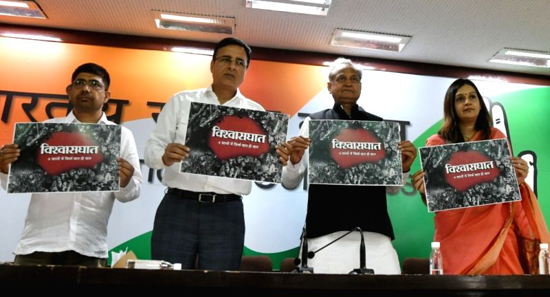 Congress leaders Ashok Gehlot and Randeep Singh Surjewala release the party's protest posters for 'Vishwashghaat' (India Betrayed) Campaign - which highlights the failures of four years of ...(Image Source: IANS)