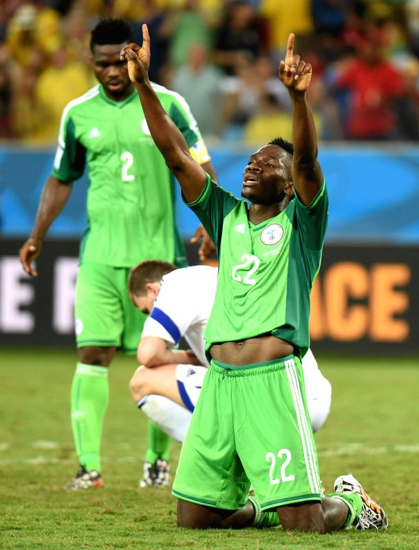 Nigeria's Kenneth Omeruo (front) celebrates the victory after a Group F match between Nigeria and Bosnia and Herzegovina of 2014 FIFA World Cup at the Arena Pantanal(Image Source: Xinhua/Liu Dawei/IANS)