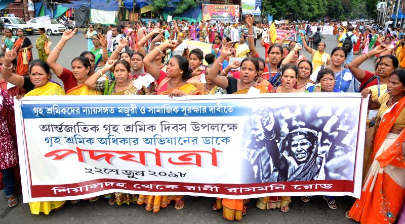 Domestic workers participate in a rally to press for their demands in Kolkata, on  June 22, 2018(Image Source: IANS)