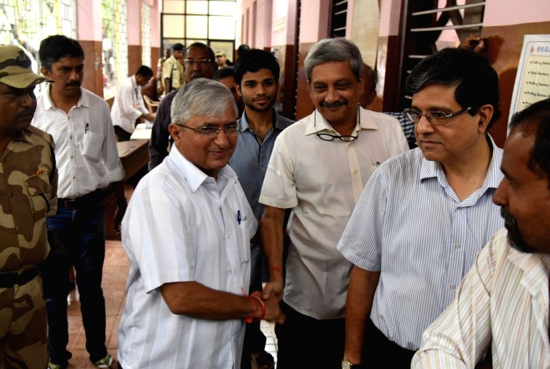 Goa Chief Minister Manohar Parrikar and Bhasha Suraksha Manch leader Subhash Velingkar in a queue to cast their vote during Panaji bypolls on Aug 23, 2017.
