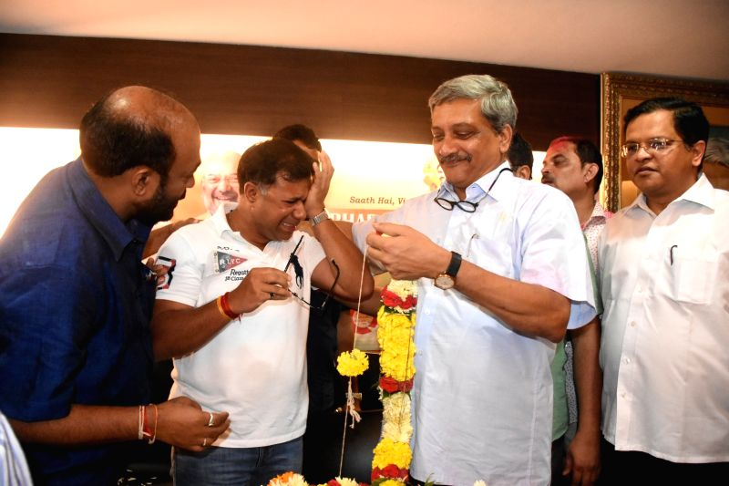 Goa Chief Minister Manohar Parrikar and Health Minister Vishwajit Rane celebrating after wining the Panaji and Valpoi bypolls in Panaji on Aug. 28, 2017.