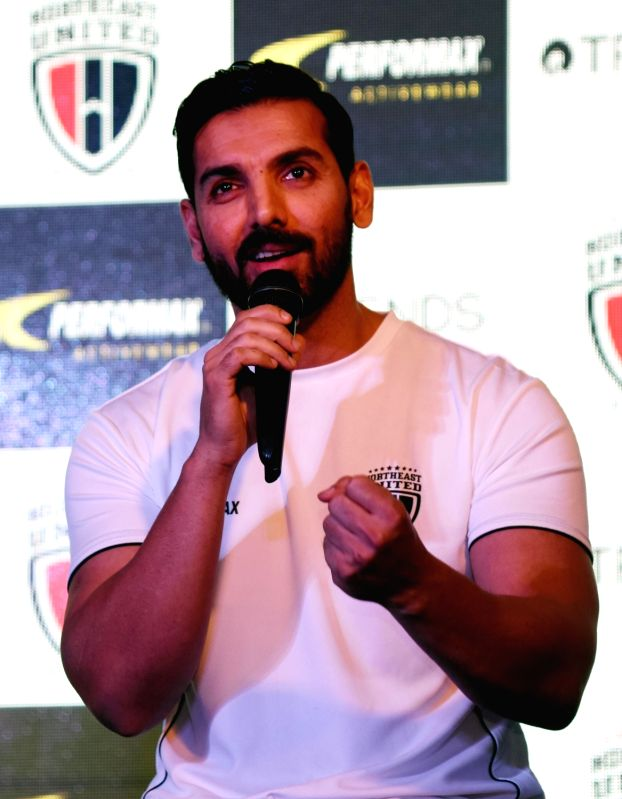 : Guwahati: NorthEast United Football Club owner John Abraham addresses during a press meet ahead of the Hero Indian Super League 2017 in Guwahati on Nov 14, 2017. (Photo: IANS).