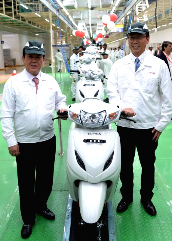 Honda Motorcycle and Scooter India Pvt Ltd Regional Operations (Asia and Oceania) Chief Officer Shinji Aoyama and President and CEO Minoru Kato during the inauguration of World's largest ...