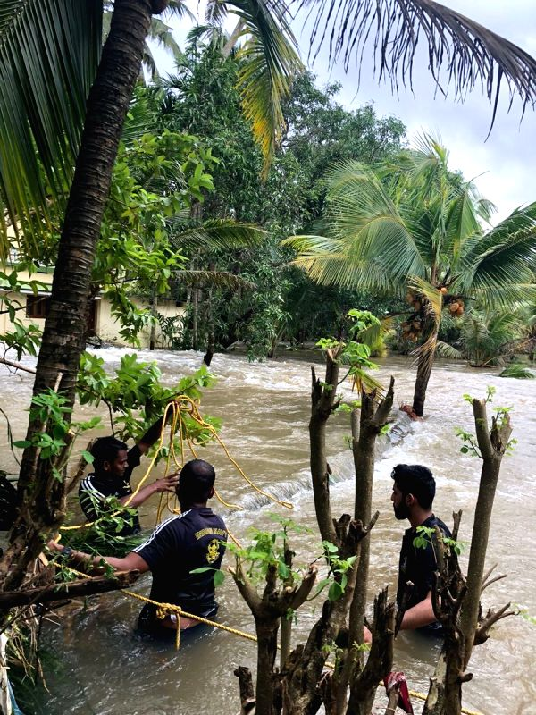 Indian Navy personnel carry out rescue operations in flood-hit Kerala's Thrissur on Aug 20, 2018.(Image Source: IANS/DPRO)