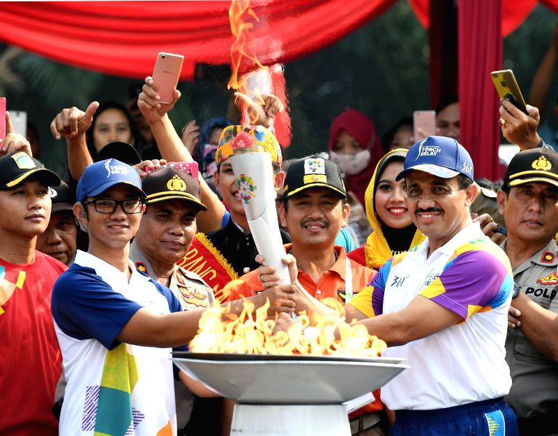 JAKARTA, Aug. 15, 2018 - Mayor of East Jakarta M. Anwar (R Front) participates in the Torch Relay in Jakarta, Indonesia, Aug. 15, 2018. The 2018 Asian Games will kick off here on Aug. 18.(Image Source: Xinhua/Li He/IANS)