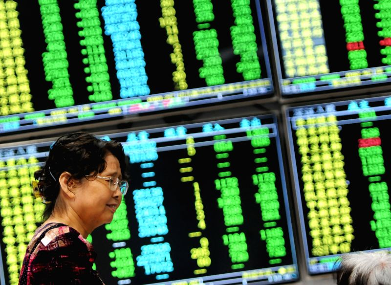 JIUJIANG, June 19, 2018 - A woman is seen at a stock exchange in Jiujiang, east China's Jiangxi Province, June 19, 2018. Chinese stocks closed lower on Tuesday, with the benchmark Shanghai Composite ...(Image Source: Xinhua/Hu Guolin/IANS)