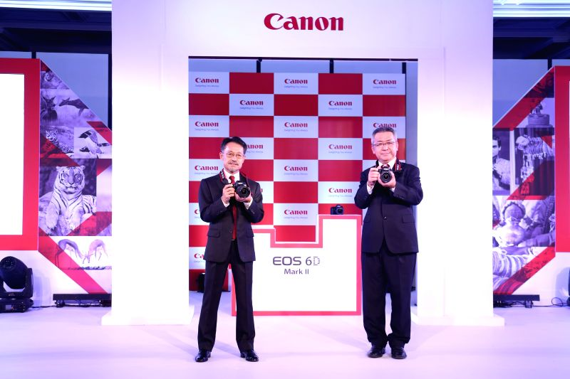 Kazutada Kobayashi, President and CEO, Canon India and Eddie Udagawa, Vice President of Consumer Imaging and Information Centre, Canon India while launching EOS 6D Mark II in India on Monday. (Photo: ...