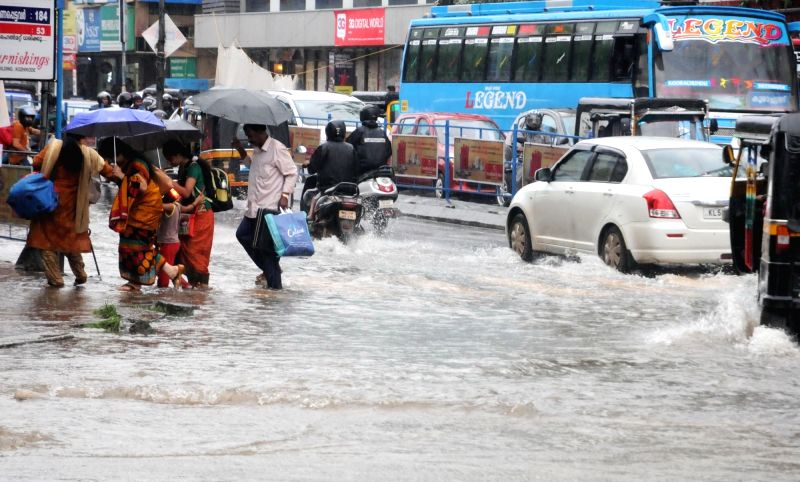 : Kozhikode: A view of flooded streets of Kozhikode of Kerala after heavy rains lashed the city on Aug 14, 2018. For a second successive day, heavy rains lashed Kerala's Kozhikode, Malappuram ...(Image Source: IANS)