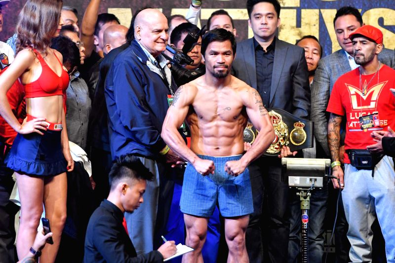 KUALA LUMPUR, July 14, 2018 - Boxing legend Manny Pacquiao (C) weighs in Kuala Lumpur, Malaysia, July 14, 2018. The highly anticipated fight between Manny Pacquiao and Lucas Matthysse, the ...(Photo:Xinhua/Chong Voon Chung/IANS)