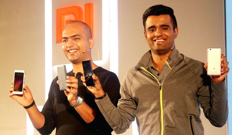 (L to R) Xiaomi India Vice President and Managing Director Manu Jain and product lead Jai Mani during the launch of Redmi's 4A smartphone, in New Delhi on March 20, 2017.