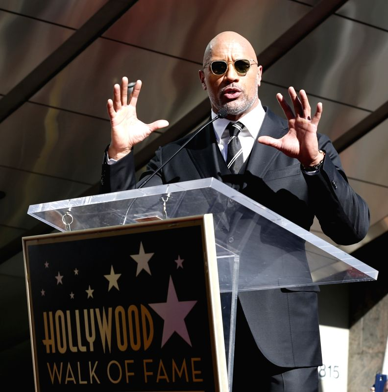 LOS ANGELES, Dec. 14, 2017 - Dwayne Johnson speaks at his Hollywood Walk of Fame Star ceremony in Los Angeles, the United States, Dec. 13, 2017. Dwayne Johnson was honored with a star on the ...