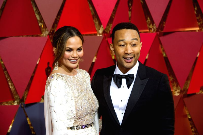 LOS ANGELES, Feb. 27, 2017 - Singer John Legend (R) and his wife U.S. model Chrissy Teigen arrive for the red carpet of the 89th Academy Awards at the Dolby Theater in Los Angeles, the United States, ...