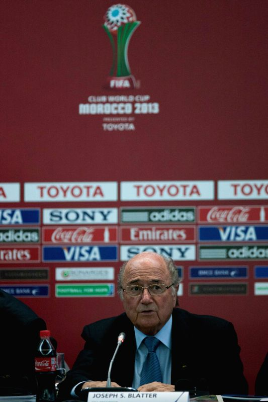 : MARRAKECH, Dec. 19, 2013 (Xinhua/IANS)FIFA President Joseph Blatter speaks during a news conference at the FIFA's 2013 Club World Cup soccer tournament in Marrakech, Morocco, Dec. 19, ...