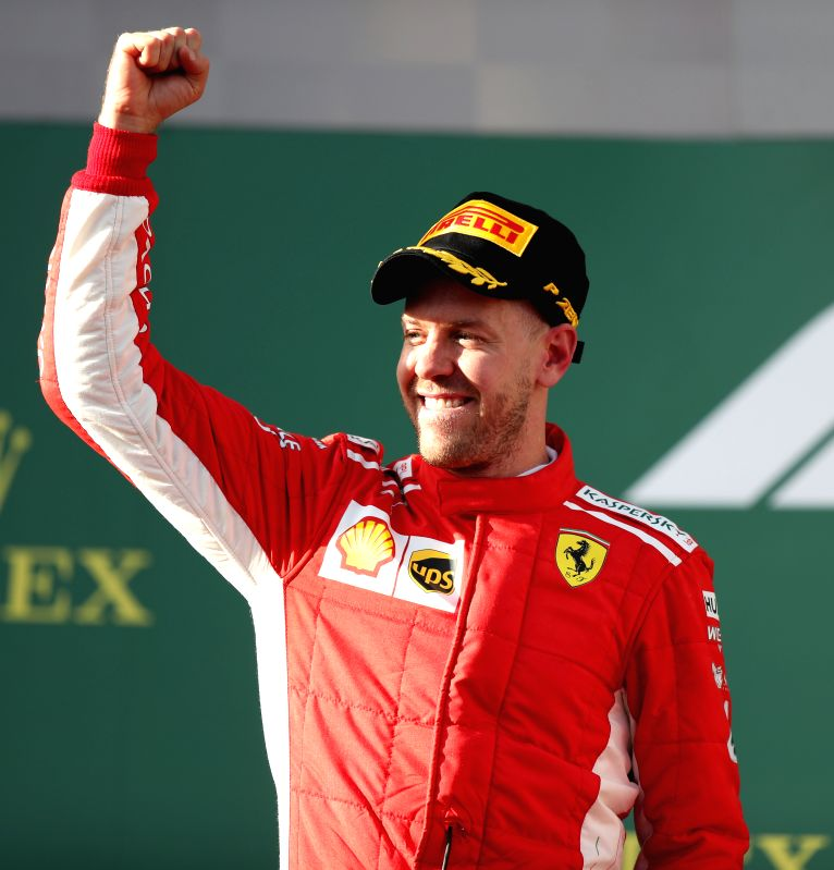 MELBOURNE, March 25, 2018 - Ferrari's Sebastian Vettel of Germany celebrates on the podium during the awarding ceremony for Australian Formula One Grand Prix in Melbourne, Australia, March 25, 2018. ...(Photo:Xinhua/Bai Xuefei/IANS)