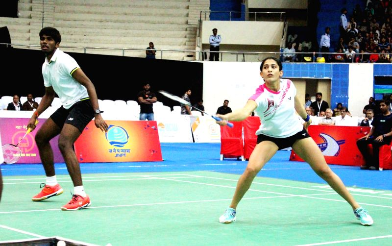 Mixed doubles pair of Ashwini Ponnappa and Satwiksairaj Rankireddy in action against Pranaav Jerry Chopra and N Sikki Reddy during the 82nd Senior National Badminton Championship 2017 at ...(Image Source: IANS)