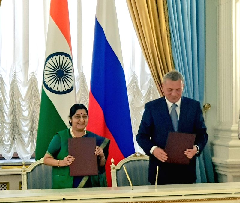 : Moscow: External Affairs Minister Sushma Swaraj and Russian Deputy Prime Minister Yuri Borisov at the signing ceremony of Protocol after the successful conclusion of plenary session of the 23rd ...(Image Source: IANS)