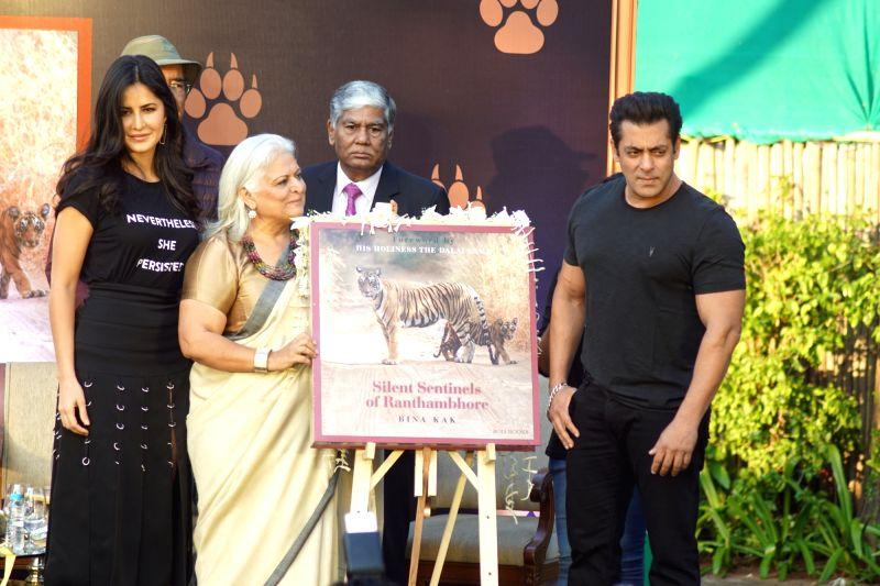 :Mumbai: Actors Salman Khan and Katrina Kaif with Bina Kak at the launch of her book
