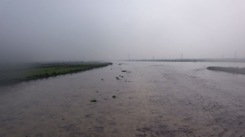 : New Delhi: A view of an overflowing Yamuna river, in New Delhi on July 28, 2018. Water released from Haryana's Hathnikund added to the continued rains have led the Yamuna river to breach its ...(Image Source: IANS)