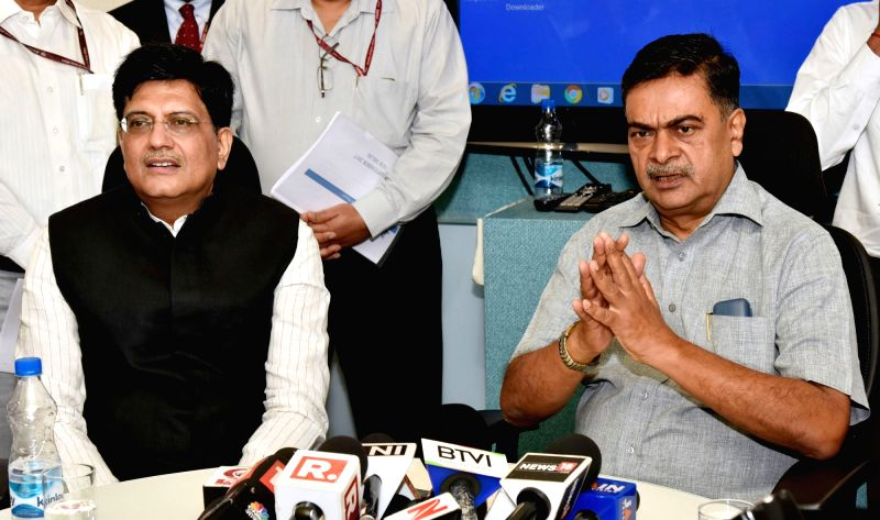 : New Delhi: Union MoS Power and New and Renewable Energy R.K. Singh talks to the press after taking charge of his ministries in the presence of Union Railways and Coal Minister Piyush Goyal in New ...