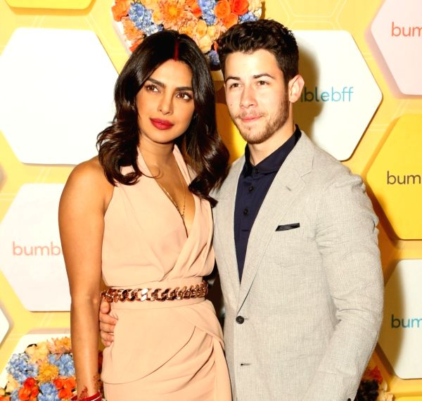 Newlyweds Priyanka Chopra and Nick Jonas during the launch party of her new project dating app Bumble in New Delhi(Image Source: Amlan Paliwal/IANS)