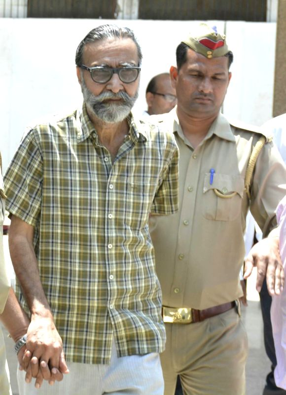 Nithari killings' convict Moninder Singh Pandher being taken away after produced before a CBI court in Ghaziabad on July 24, 2017. A CBI court convicted businessman Moninder Singh Pandher ...