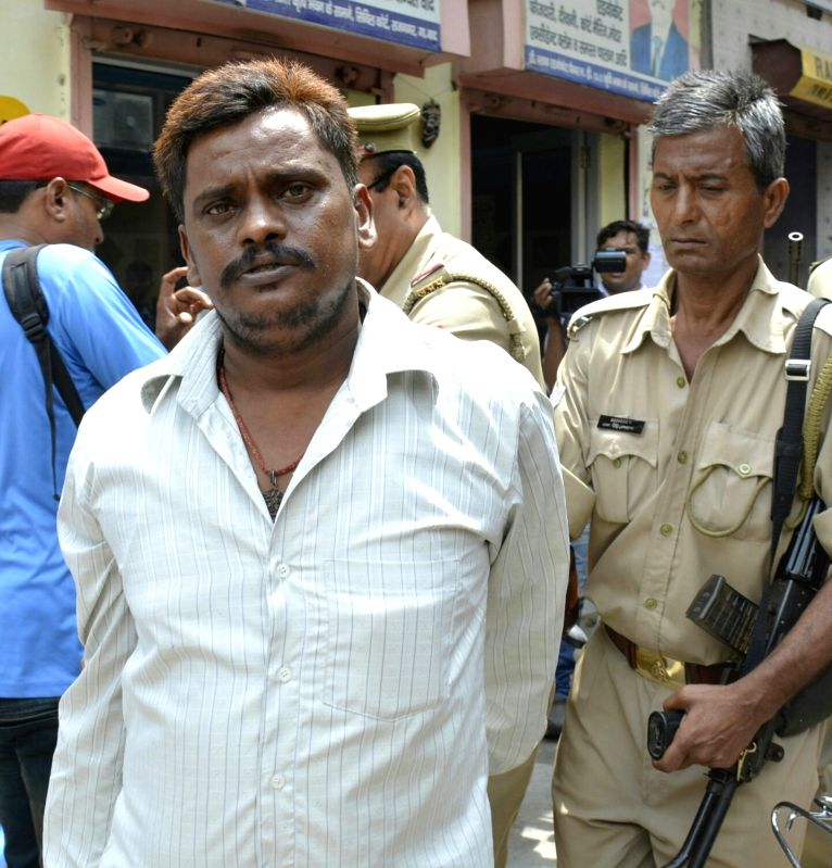 Nithari killings' convict Surender Koli being taken away after produced before a CBI court in Ghaziabad on July 24, 2017. A CBI court convicted businessman Moninder Singh Pandher and his ...