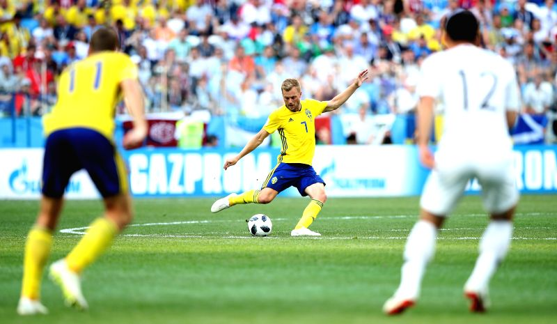 NIZHNY NOVGOROD, June 18, 2018 - Sebastian Larsson (C) of Sweden passes the ball during a group F match between Sweden and South Korea at the 2018 FIFA World Cup in Nizhny Novgorod, Russia, June 18, ...