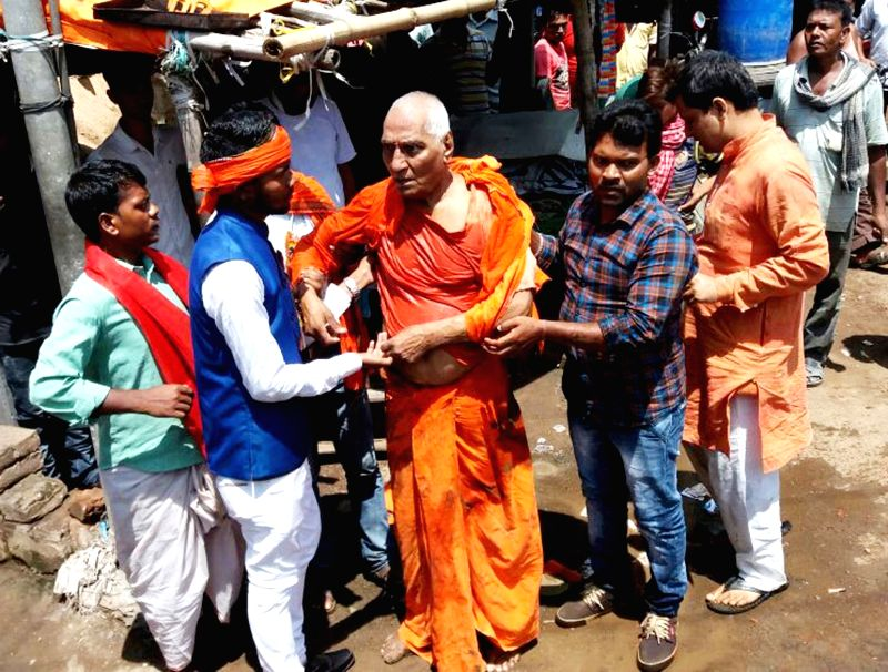": Pakur: Injured Social activist Swami Agnivesh being taken to the hospital after suspected Bharatiya Janata Yuva Morcha (BJYM) activists thrashed him while shouting ""Jai Shri Ram"" slogans in ...(Image Source: IANS)"
